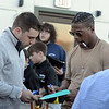 RYAN HUTTON/ Staff photo<br /> Alex Andon, of Malden, left, gets an autograph from Patriots Defensive back Brandon King at the Stellato Sports Draft Party at the Ferncroft Country Club.