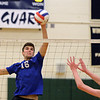 RYAN HUTTON/ Staff photo<br /> Salem's Alexander Stift readies a spike over the net during Monday's game at Windham High.
