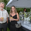 CARL RUSSO/staff photo. Steve Flynn, owner of Nunan Florist and Greenhouse in Georgetown and manager, Stephanie Gragg stand next to an ice sculpture of the castle. The Winnekenni Foundation's 50th Anniversary Summer Wine and Cheese Reception was celebrated on Thursday Evening August 23rd. Over 100 people enjoyed the Castle's atmosphere and gorgeous flower gardens while listening to music by the Itchy Feet Jazz Band. The foundation honored special guests Lucine and Richard Goudreault  of The Goudreault Farm and Dean Bouzianis, first president of The Winnekenni Foundation for their dedication. 8/23/2018