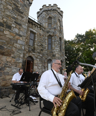 CARL RUSSO/staff photo. Saxaphone players Artie Bakopolus, left and Lou Stamas and other members of the Itchy Feet Jazz Band entertain the audience. The Winnekenni Foundation's 50th Anniversary Summer Wine and Cheese Reception was celebrated on Thursday Evening August 23rd. Over 100 people enjoyed the Castle's atmosphere and gorgeous flower gardens while listening to music by the Itchy Feet Jazz Band. The foundation honored special guests Lucine and Richard Goudreault  of The Goudreault Farm and Dean Bouzianis, first president of The Winnekenni Foundation for their dedication. 8/23/2018