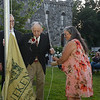CARL RUSSO/staff photo. Grace Marcoux, president of The Winnekenni Foundation is assisted by honoree  Dean Bouzianis, first president of The Winnekenni Foundation in raising the Winnekenni Castle flag with some help from Thomas Sullivan, foundation trustee and Haverhill City councilor. The Winnekenni Foundation's 50th Anniversary Summer Wine and Cheese Reception was celebrated on Thursday Evening August 23rd. Over 100 people enjoyed the Castle's atmosphere and gorgeous flower gardens while listening to music by the Itchy Feet Jazz Band. The foundation honored special guests Lucine and Richard Goudreault  of The Goudreault Farm and Dean Bouzianis, first president of The Winnekenni Foundation for their dedication. 8/23/2018