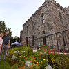 CARL RUSSO/staff photo. Eric and Karen Landers of Andover admire the flower gardens. Eric works for Pentucket Bank of Haverhill, a sponsor of the event. The Winnekenni Foundation's 50th Anniversary Summer Wine and Cheese Reception was celebrated on Thursday Evening August 23rd. Over 100 people enjoyed the Castle's atmosphere and gorgeous flower gardens while listening to music by the Itchy Feet Jazz Band. The foundation honored special guests Lucine and Richard Goudreault  of The Goudreault Farm and Dean Bouzianis, first president of The Winnekenni Foundation for their dedication. 8/23/2018