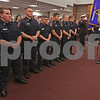 MIKE SPRINGER/Staff photo<br /> Newly hired Fire Department personnel stand at attention for the posting of the colors Thursday during a promotion ceremony for Lt. Ronald Sebastian at the Derry Municipal Building. Standing in the first row are, from left, firefighter Alex Phillips, paramedic John Davis, paramedic Thomas Gillis, paramedic Zhifeng Lian, paramedic Jason Landry and inspector David Eastman. Behind them at far left is Lt. Sebastian.<br /> 11/29/2018