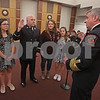 MIKE SPRINGER/Staff photo<br /> Derry Fire Chief Michael J. Gagnon, right, administers the oath of office for Lt. Ronald Sebastian during a promotion ceremony Thursday at the Derry Municipal Building. Standing along side Sebastian are, from left, daughter Lilly, 16, wife Amy and daughter Emma, 13.<br /> 11/29/2018