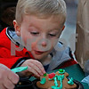 MIKE SPRINGER/Staff photo<br /> Three-year-old Joshua Martin of Salem decorates a gingerbread cookie during the tree-lighting festivities Sunday at the Loop shopping mall in Methuen.<br /> 12/02/2018