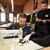 RYAN HUTTON/ Staff photo<br /> 1620 Workwear co-founders Ted De Innocentis, left, and Josh Walker, right, work on hemming some of the company's new pants in the company's workshop on Wingate Street in Haverhill on Tuesday.