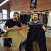 RYAN HUTTON/ Staff photo<br /> 1620 Workwear co-founders Ted De Innocentis, right, and Josh Walker, left, show off some of the company's new shorts and pants in the company's workshop on Wingate Street in Haverhill on Tuesday.