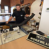 RYAN HUTTON/ Staff photo<br /> 1620 Workwear co-founder Josh Walker readies a pair of pants to hem in the company's workshop on Wingate Street in Haverhill on Tuesday.
