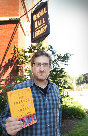 """BRYAN EATON/Staff photo. Spencer Wise has published his first novel, """"The Emperor of Shoes,"""" about a father and son from the North Shore/Merrimack Valley working in the shoe business in China. Wise grew up in Andover, and mentions the town library in his acknowledgements."""