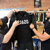 RYAN HUTTON/ Staff photo<br /> 1620 Workwear co-founders Ted De Innocentis, left, and Josh Walker, right, put one of the company's new jackets on a mannequin in the company's workshop on Wingate Street in Haverhill on Tuesday.