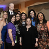 CARL RUSSO/Staff photo. STEPPING OUT: Governor Charlie Baker poses for a photo with Greater Lawrence Family Health Center staff and guest. Front row from left: Diane Martin, Nora Ortiz and Srinidhi Yerramaneni. Back row: Jill Leifer, a dinner guest of GLFHC; Alicia Mam DaCunha,  Silvia Rivera and Ashley Rogers. <br /> <br /> The Greater Lawrence Family Health Center's annual making a Difference Gala was held Thursday night on April 12 at the Andover Country Club. Massachusetts Governor,Charlie Baker was the keynote speaker. Lawrence Mayor, Daniel Rivera was this year's recipient of the Making A Difference award for his work on opioids and the homeless. 4/12/2018