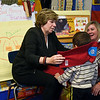 RYAN HUTTON/ Staff photo<br /> Randi Weingarten, president of the American Federation of Teachers, drapes a scarf around the neck of Alexis Oliveras in Jennifer Cahill's classroom at the Breen School in Lawrence on Thursday. Weingarten was in town to hand out scarves and hats to students and meet with local union leaders.