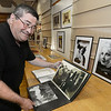 CARL RUSSO/Staff photo. STEPPING OUT: Tony Giglio of Reading looks at a Thelma Todd photo album at the party. Portraits of Todd, right, were also on display.  <br /> <br /> The dedication of the Thelma Todd Theater and her 112th birthday party were celebrated at the Heritage State Park in Lawrence on Sunday, July 29th. Todd was a Lawrence girl who won the Miss Massachusetts pageant in 1925 before launching her career in Hollywood. As an actress, Todd was known as the ''ice cream blond'' and was having a successful movie career in comedy. She died mysteriously in 1935 from carbon monoxide poisoning. She was only 29 years old. 11/01/2018