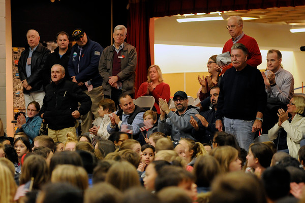 TIM JEAN/Staff photo<br /> <br /> Members of the US Army stand to be recognized during a Salute to Veterans program at the Pvt. Albert E. Thomson Elementary School. The school is named in honor of Pvt. Albert E. Thomson, who was killed in World War I on Nov. 9, 1918, 100 years ago this day.  11/9/18