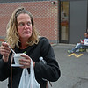 "MIKE SPRINGER/Staff photo<br /> Lisa Gifford eats a pasta salad from her bagged meal on Monday outside the Cor Unum (Latin for ""One Heart"") center in Lawrence. Gifford, who is homeless, is a regular at the center. ""It helps us out a lot,"" she said. ""The people are kind. They care.""<br /> 10/1/2018"