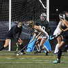 CARL RUSSO/staff photo. Andover's Paige Fabiani, left and Central's Caitlin Finneran fight for the loose ball after Andover's goalie, Allison Gasperoni makes the save. Andover defeated Central Catholic 3-0 in field hockey action. 10/01/2018