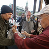 "MIKE SPRINGER/Staff photo<br /> Jack Kaslow hands a bagged meal to Eric Silva on Monday at the Cor Unum (Latin for ""One Heart"") center in Lawrence. ""If it wasn't for this place,"" said Silva, who has been homeless for a month and a half, ""I'd be one hungry person. God bless them.""<br /> 10/1/2018"