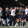 CARL RUSSO/staff photo. Andover's Joanna Archambault, 19, raises her stick in celebration with her teammates. Andover defeated Central Catholic 3-0 in field hockey action. 10/01/2018