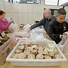 "MIKE SPRINGER/Staff photo<br /> Volunteers, from left, Pamela DeSimone, Jimmy Porter and Alexis Martinez assemble bagged lunches for the needy on Monday at the Cor Unum (Latin for ""One Heart"") center in Lawrence.<br /> 10/1/2018"