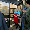 "MIKE SPRINGER/Staff photo<br /> Sandra Sharpe talks with people lined up for bag meals on Monday at the Cor Unum (Latin for ""One Heart"") center in Lawrence.<br /> 10/1/2018"