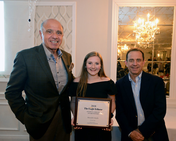 RYAN HUTTON/ Staff photo<br /> Haverhill High's Meredith Budds, center, poses with Commonwealth Motors owner Charlie Daher, left, and Boston Marathon Race Director Dave McGillivary, right, after being named the Eagle-Tribune's Student Athlete of the Year during the awards banquet at Michael's Function Hall on Wednesday night.