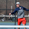 CARL RUSSO/Staff photo Central Catholic senior captain, Adrian Suciu competes against North Andover senior captain, Sean Pfordresser in tennis singles Monday afternoon. 4/01/2019