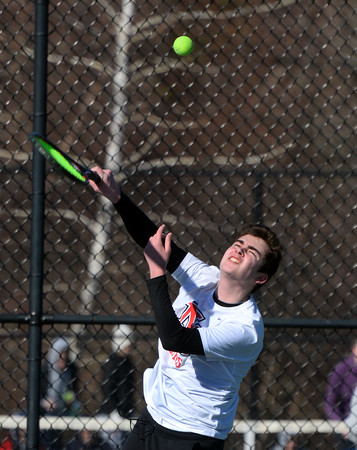 CARL RUSSO/Staff photo North Andover senior captain, Sean Pfordresser competes against Central Catholic senior captain, Adrian Suciu in tennis singles Monday afternoon. 4/01/2019