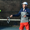 CARL RUSSO/Staff photo Central Catholic senior captain, Adrian Suciu competes against North Andover senior captain, Sean Pfordresser in tennis singles Monday afternoon. 4/1/2019