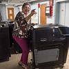 AMANDA SABGA/Staff photo<br /> <br /> City Councilor Ana Levy reacts at the comparison of new voting machines to old ones as they are exchanged at Lawrence City Hall. <br /> <br /> 8/1/19