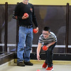CARL RUSSO/Staff photo John Kemp of Plaistow NH watches his godson, Josh Willette, 10 of Methuen roll his bocce ball during a match. They were teammates on Rylee's Warriors during the tournament. <br /> <br /> Twenty two teams with 100 players participated in the 4th Annual Foster Kids of the Merrimack Valley Bocce and eight teams participated in first corn hole tournament on Saturday, April 27 at the Methuen Sons of Italy.  <br /> <br /> The event helps to support the Helene Giordano Memorial Scholarship Fund. Helene Giordano, who passed away in 1990, was Larry Giordano's foster mother. <br /> <br /> Two--$2,500 scholarships are given each year to young adults who are in or have been in foster care thru the Lawrence or Haverhill DCF, Department of Children and Families offices. 4/27/2019