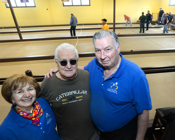 CARL RUSSO/Staff photo Eileen and Larry Giordano of Methuen and Jim Tsouprakakis, center, of Dracut officially open the 4th Annual Foster Kids of the Merrimack Valley Bocce Tournament. Larry is founder and president of Foster Kids of the Merrimack Valley Inc. and Eileen is vice president. Jim is this year's tournament director. <br /> <br /> Twenty two teams with 100 players participated in the 4th Annual Foster Kids of the Merrimack Valley Bocce and eight teams participated in first corn hole tournament on Saturday, April 27 at the Methuen Sons of Italy.  <br /> <br /> The event helps to support the Helene Giordano Memorial Scholarship Fund. Helene Giordano, who passed away in 1990, was Larry Giordano's foster mother. <br /> <br /> Two--$2,500 scholarships are given each year to young adults who are in or have been in foster care thru the Lawrence or Haverhill DCF, Department of Children and Families offices. 4/27/2019