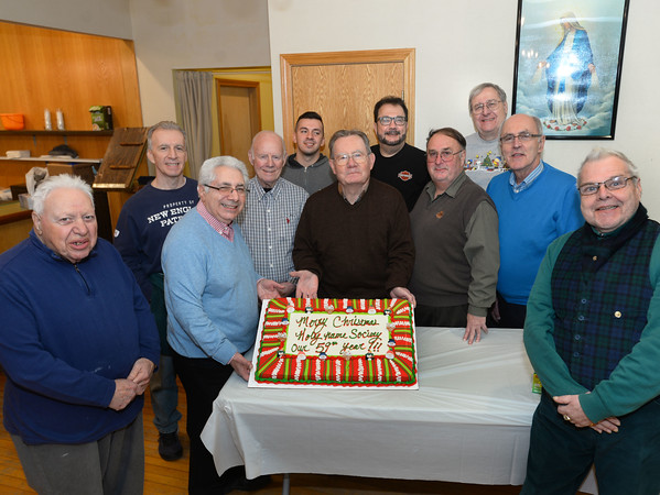 CARL RUSSO/Staff photo. STEPPING OUT:  Members of the Holy Name Society with the 59th. annual Christmas Party cake. Front row from left:  Sal DiBerardinis of Lawrence; society president, Carl Benanti of Methuen; past president, Frank Ford of Methuen; secretary, Wayne Pickles of Lawrence; Manuel Silva of Methuen and Ralph Brosco of Lawrence. Back row: sergeant of arms, John Vellardita of Lawrence; Gene Thornhill of Lawrence; John Vellardita Jr. of Lawrence; Gino Baroni of Atkinson N.H. and David Boucher of Salem N.H. <br /> <br /> The Holy Name Society of Corpus Christi Parish at Holy Rosary Church in Lawrence held its 59th. Annual Christmas Party for Exceptional Adults and Children on Sunday, December 1st. at the Parish Center. <br /> <br /> Over one hundred guest, family members and caregivers were treated to a Pasta and meatball dinner and a large Christmas cake for dessert. The highlight of the party was a visit from Santa who handed out Christmas gifts. The music was provided by The Holy Name Society's Christmas Party Band. 12/1/2019