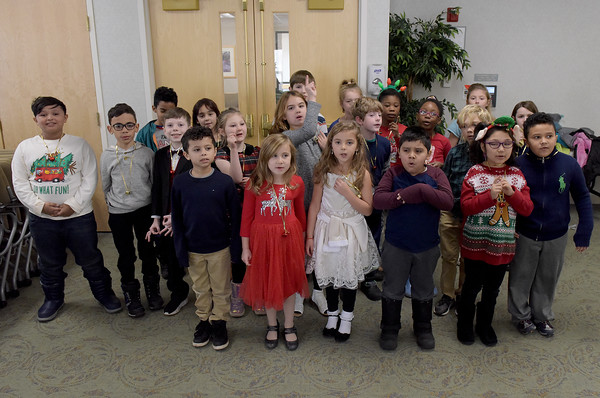 TIM JEAN/Staff photo <br /> <br /> Students in Becca Paul's class at Hill View Montessori Public Charter School sing holiday songs to patients and staff at Whittier Rehabilitation Hospital.   12/20/19