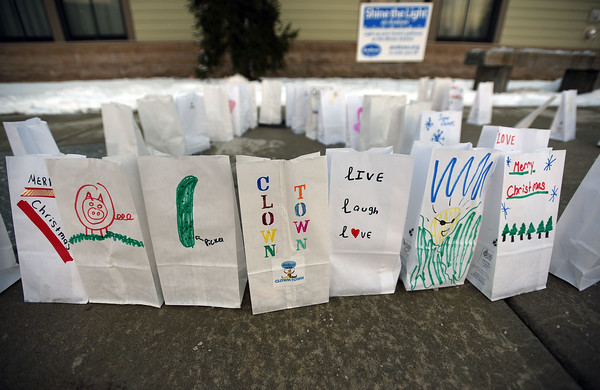 """RYAN HUTTON/ Staff photo<br /> Tea lights in bags decorated by children at the Cormier Youth Center are arranged out front as part of the """"Light Up the Night"""" initiative."""