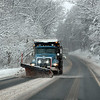 RYAN HUTTON/ Staff photo<br /> A plow clears a stretch of Route 125 in Andover during Monday morning's storm.
