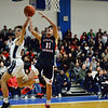 CARL RUSSO/Staff photo. Lawrence's Jeremiah Melendez stops Central's Adrian Rodriguez from making the basket on a break away. Lawrence high defeated Central Catholic 55-51 in the 7th. Annual Commonwealth Motors Christmas Classic basketball tournament. 12/27/2019
