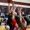 \CARL RUSSO/Staff photo. Whittier's Lilly Meekins drives to the hoop against Lynn Tech defenders. Whittier Tech scrimmaged against Lynn Tech in girls basketball action Monday afternoon. 12/09/2019