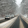 RYAN HUTTON/ Staff photo<br /> Route 125 in Andover is blanketed in snow during Monday morning's storm.