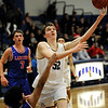TIM JEAN/Staff photo <br /> <br /> Andover's Aidan Cammann scores against Londonderry's Mike Rosatano during the Commonwealth Motors Christmas Classic basketball tournament.   12/27/19