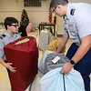 CARL RUSSO/Staff photo. Methuen high US Army JROTC cadets, Staff Sgt. Nick Gomez, left, a junior and private 1st. class Nathaniel Hashem, a freshman organize bags of Christmas presents. Each foster child receives a bag filled with gifts.  <br /> <br /> Foster Kids of the Merrimack Valley, a non-profit organization held its 14th. annual Wrapping Party Thursday night at St. Lucy's Parish in Methuen. Over 150 volunteers participated in wrapping hundreds of gifts for the kids. Eileen and Larry Giordano of Methuen are the founders of Foster Kids of the Merrimack Valley Inc. with Larry as president and Eileen as vice president. 12/12/2019