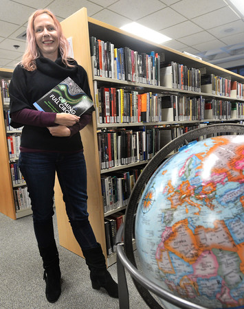 CARL RUSSO/Staff photo. Kristi Arford, an anthropology professor at Northern Essex Community College, displays the textbook she wrote for her classes. <br /> <br /> Arford, who has been teaching anthropology at Northern Essex for 11 years, said she was not satisfied with the textbooks she had been using, so during her sabbatical leave, she wrote one.12/09/2019