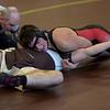 TIM JEAN/Staff photo <br /> <br /> North Andover's Jack Carbone pins Haverhill's Hunter Bourassa in the 195 pound match.     12/24/19