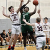 CARL RUSSO/staff photo. Brooks' Myles Foster fights his way to the hoop against Lawrence Academy's Matt Ragan, left and Tommy Fontanella.  Lawrence Academy at Brooks School in boys basketball action. 12/11/2019