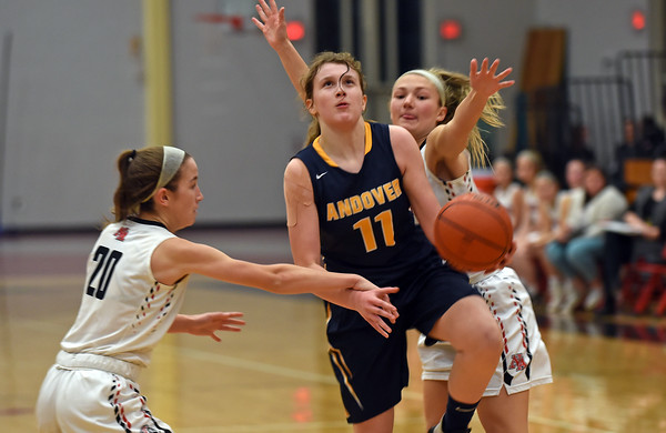 RYAN HUTTON/ Staff photo<br /> Andover's Amelia Hanscom, center, tries to put up a shot between North Andover defenders Sara Melody, left, and Hannah Whipple, right, during the third period of Friday's game at North Andover.