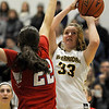 TIM JEAN/Staff photo <br /> <br /> Andover's Anna Foley, right, shoots over Natick's Brenna McDonald during the Commonwealth Motors Christmas Classic basketball tournament. Natick defeated Andover 52-37.  12/31/19