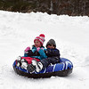 RYAN HUTTON/ Staff photo<br /> Ryan Jackson, 10, right, and Adrianna Ploof, 6, speed down the sledding hill at Alexander Carr Park in Derry on Monday.