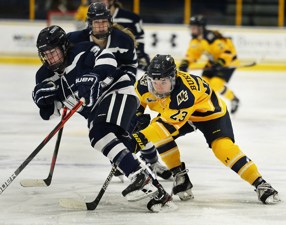 CARL RUSSO/Staff photo. Merrimack's Kate Bukolska chases UNH's Annie Berry as she moves the puck. The Merrimack College Warriors were defeated by the University of New Hampshire Wildcats in women's hockey action Friday night.12/06/2019