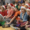 TIM JEAN/Staff photo <br /> <br /> Children watch a video before receiving gift cards from Tuscan Brands owner Joe Faro and his family at the Boys and Girls Club of Greater Salem.   12/18/19