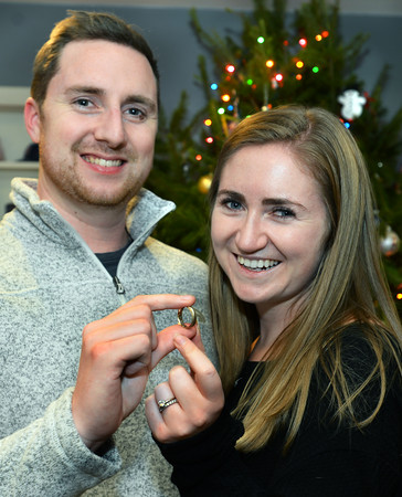 CARL RUSSO/Staff photo. Bill and Katie Giguere of North Andover holding his wedding ring. They have been married for three years.  Bill Giguere, an avid hiker, lost the wedding ring while climbing Mount Hancock in New Hampshire. A fellow hiker who heard about Bill's plight found the ring with a metal detector. 12/02/2019