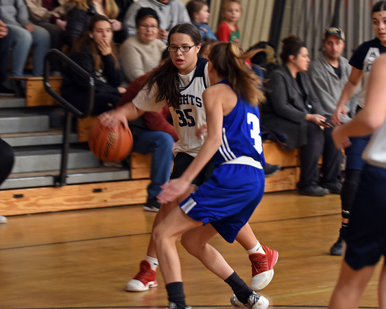 RYAN HUTTON/ Staff photo<br /> Nettle Middle School's Lexi Cortes tries to drive past Hunking Middle School's Sam Guertin during Thursday afternoon's game at Nettle.
